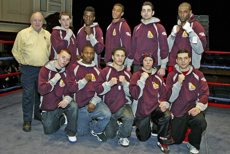 In this Feb. 17, 2010, photo, Tamerlan Tsarnaev, fifth from left, top row, accepts the trophy poses with his team at 2010 New England Golden Gloves Championship in Lowell, Mass. Tsarnaev, 26, who had been known to the FBI as Suspect No. 1 in the Boston Marathon Explosions and was seen in surveillance footage in a black baseball cap, was killed overnight on Friday, April 19, 2013, officials said. (AP Photo/The Lowell Sun, Julia Malakie)