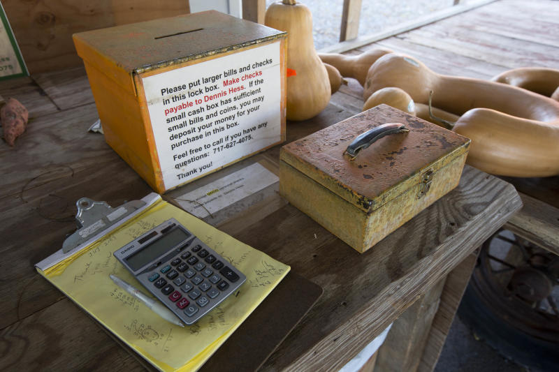 "Shown is the cash box at Dennis and Darlene Hess's farm stand Monday, Nov. 4, 2013, in Litiz, Pa. You can take our word for it: Americans don't trust each other anymore. An AP-GfK poll conducted last month found that Americans are suspicious of each other in everyday encounters. Less than a third expressed a lot of trust in clerks who swipe their credit cards, drivers on the road, or people they meet when traveling. However, there are still trusters around to set an example like Dennis Hess who runs an unattended farm stand on the honor system. Customers pick out their produce, tally their bills and drop the money into a slot, making change from an unlocked cashbox. ""When people from New York or New Jersey come up,"" said Hess, ""they are amazed that this kind of thing is done anymore."" (AP Photo/Matt Rourke)"