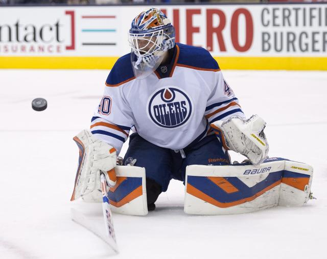 Edmonton Oilers goaltender Devan Dubnyk makes a save on the Toronto Maple Leafs during the second period of an NHL hockey game, Saturday, Oct. 12, 2013 in Toronto. (AP Photo/The Canadian Press, Frank Gunn)