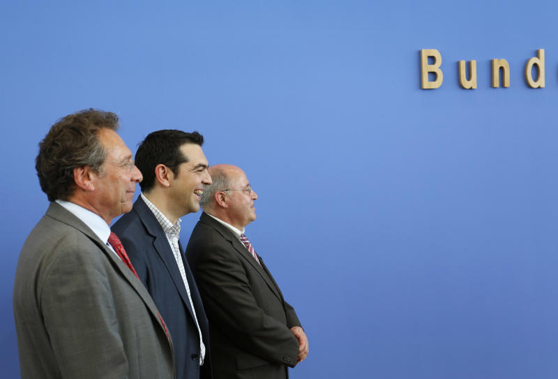 Alexis Tsipras, center, the leader of Greece's anti-austerity Syriza coalition, arrives for a press conference with leaders of Germany's Left Party Klaus Ernst, left, and Gregor Gysi in Berlin, Germany, Tuesday, May 22, 2012. (AP Photo/Ferdinand Ostrop)