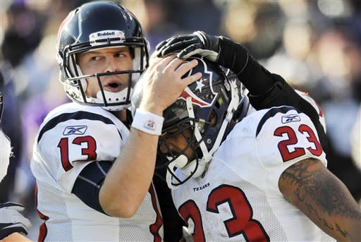 Houston Texans quarterback T.J. Yates, left, congratulates running back Arian Foster on his touchdown during the first half of an NFL divisional playoff football game against the Baltimore Ravens in Baltimore, Sunday, Jan. 15, 2012. (AP Photo/Gail Burton)