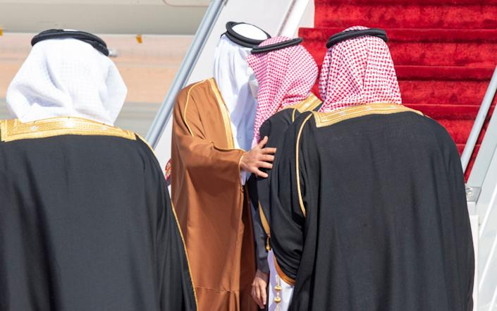 The two embraced despite wearing face masks to protect against the spread of Covid - BANDAR ALJALOUD/SAUDI ROYAL COURT HANDOUT/EPA-EFE/Shutterstock