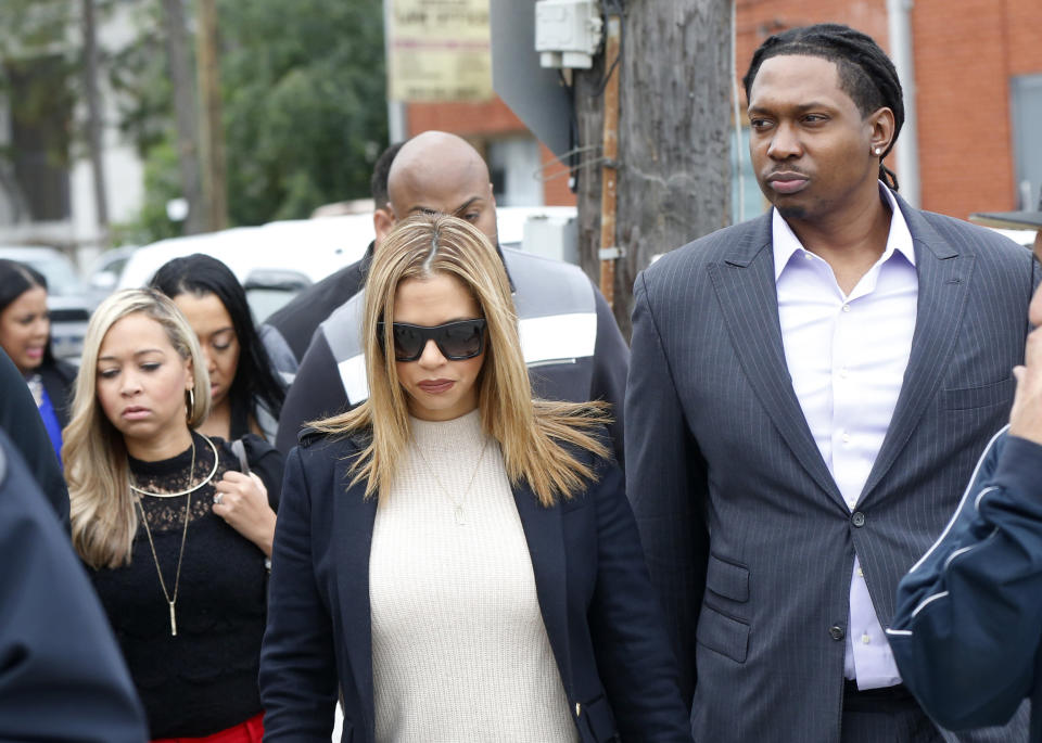 FILE- In this Dec. 7, 2016, file photo, Racquel Smith, widow of former NFL New Orleans Saints football player Will Smith, arrives with family and friends at Orleans Parish Criminal District Court, for the trial of Cardell Hayes in New Orleans. Hayes was convicted of manslaughter Sunday, Dec. 11, in the fatal shooting of Will Smith. (AP Photo/Gerald Herbert, File)