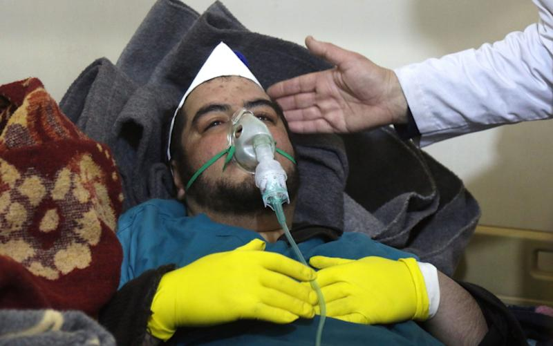 A Syrian man receives treatment following a suspected toxic gas attack in Khan Sheikhun, a rebel-held town in the northwestern Syrian Idlib province - Credit: AFP