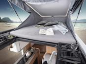 """<p>Their 2021 range adds a game-changing feature: the option for a panoramic pop-top roof. This new roof improves ventilation, provides a master suite with scenic views and allows the van to sleep up to seven passengers.</p><p><a class=""""link rapid-noclick-resp"""" href=""""https://www.gearpatrol.com/cars/a33562724/knaus-tabbert-pop-top-camper/"""" rel=""""nofollow noopener"""" target=""""_blank"""" data-ylk=""""slk:LEARN MORE"""">LEARN MORE</a></p>"""
