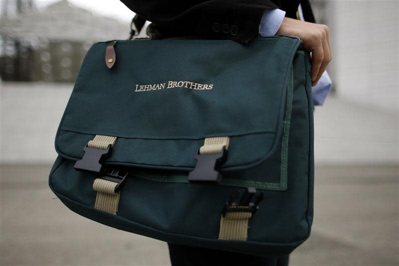 Edouard d'Archimbaud poses with his Lehman Brothers' bag before an interview with Reuters in La Defense