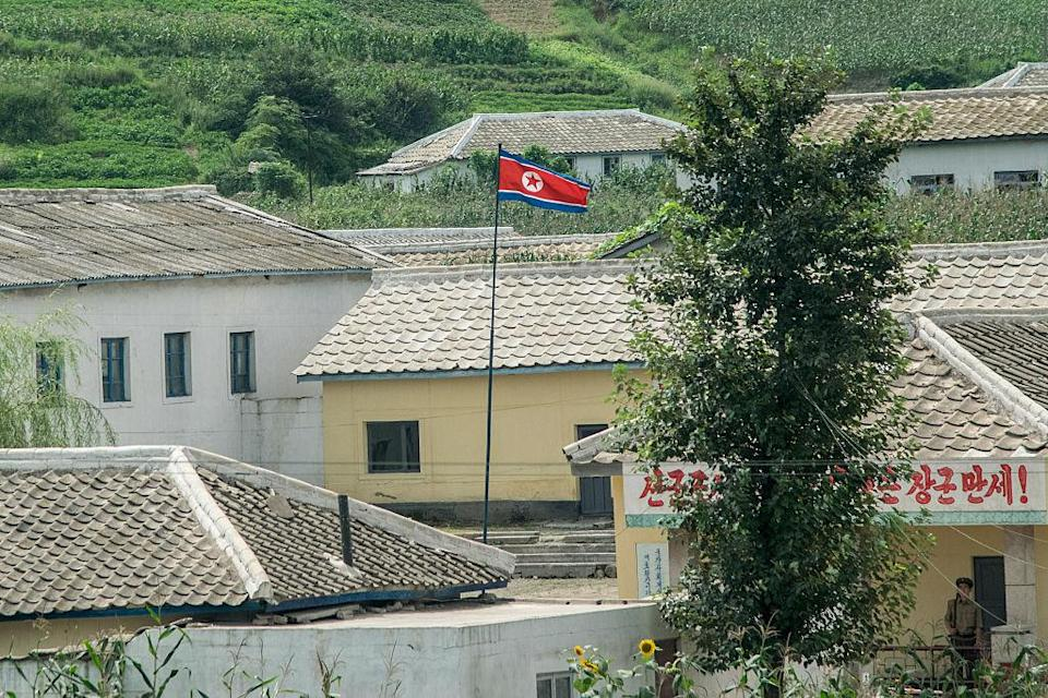 <p>The North Korea flag was officially adopted on September 9, 1948. The two blue stripes signify sovereignty, peace and friendship. the white stripes signify purity, red represents the Communist revolution and the red star is the recognized symbol of Communism. (Getty) </p>