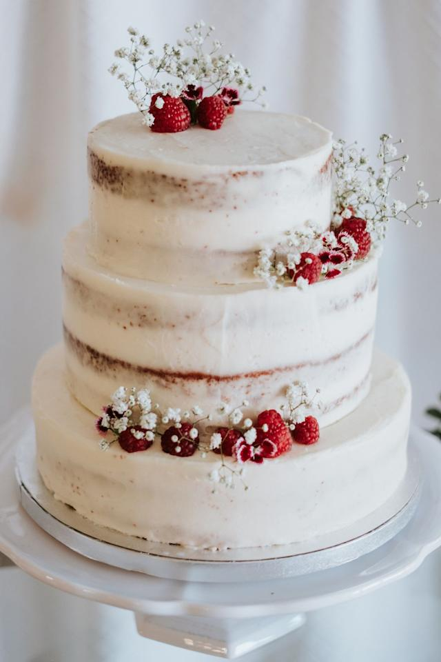 """<p><a href=""""http://www.ofeliabakery.com/"""" target=""""_blank"""">Ofelia Bakery</a> in Seville conceived this classic semi-naked, three-tiered wedding cake, which features seasonal florals and deep red raspberries. </p><p><em>Via <a href=""""https://weddingswithlove.es/portafolios/alba-nicolas/"""" target=""""_blank"""">Weddings With Love</a></em><a href=""""https://weddingswithlove.es/portafolios/alba-nicolas/"""" target=""""_blank""""></a><em><a href=""""https://weddingswithlove.es/portafolios/alba-nicolas/"""" target=""""_blank""""></a></em></p>"""