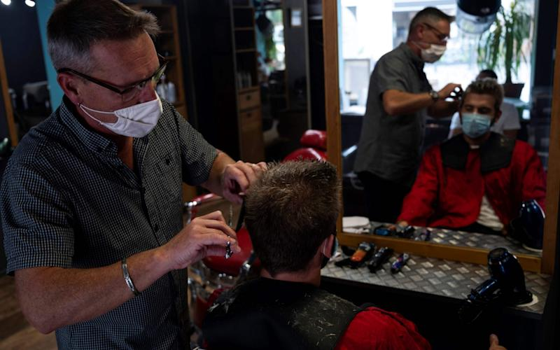 """French hairdresser Thierry Gras and founder of the environmentalist and recycling association """"Coiffeurs justes"""" (Fair hairdressers) - CHRISTOPHE SIMON/AFP"""