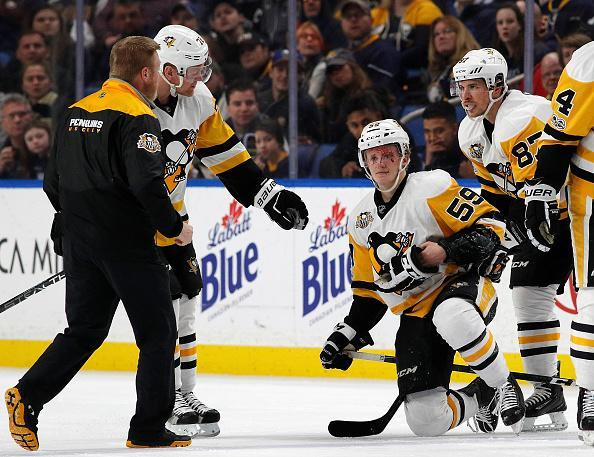"Jake Guentzel #59 of the <a class=""link rapid-noclick-resp"" href=""/nhl/teams/pit/"" data-ylk=""slk:Pittsburgh Penguins"">Pittsburgh Penguins</a> is injured after being hit by <a class=""link rapid-noclick-resp"" href=""/nhl/players/5987/"" data-ylk=""slk:Rasmus Ristolainen"">Rasmus Ristolainen</a> #55 of the <a class=""link rapid-noclick-resp"" href=""/nhl/teams/buf/"" data-ylk=""slk:Buffalo Sabres"">Buffalo Sabres</a> (not shown) during the first period at the KeyBank Center on March 21, 2017 in Buffalo, New York. (Photo by Kevin Hoffman/Getty Images)"