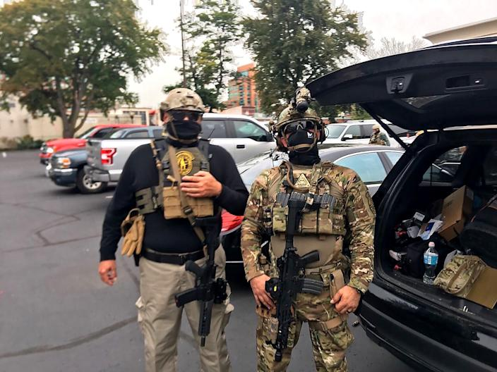Two members of the Oath Keepers are seen in Louisville this year.