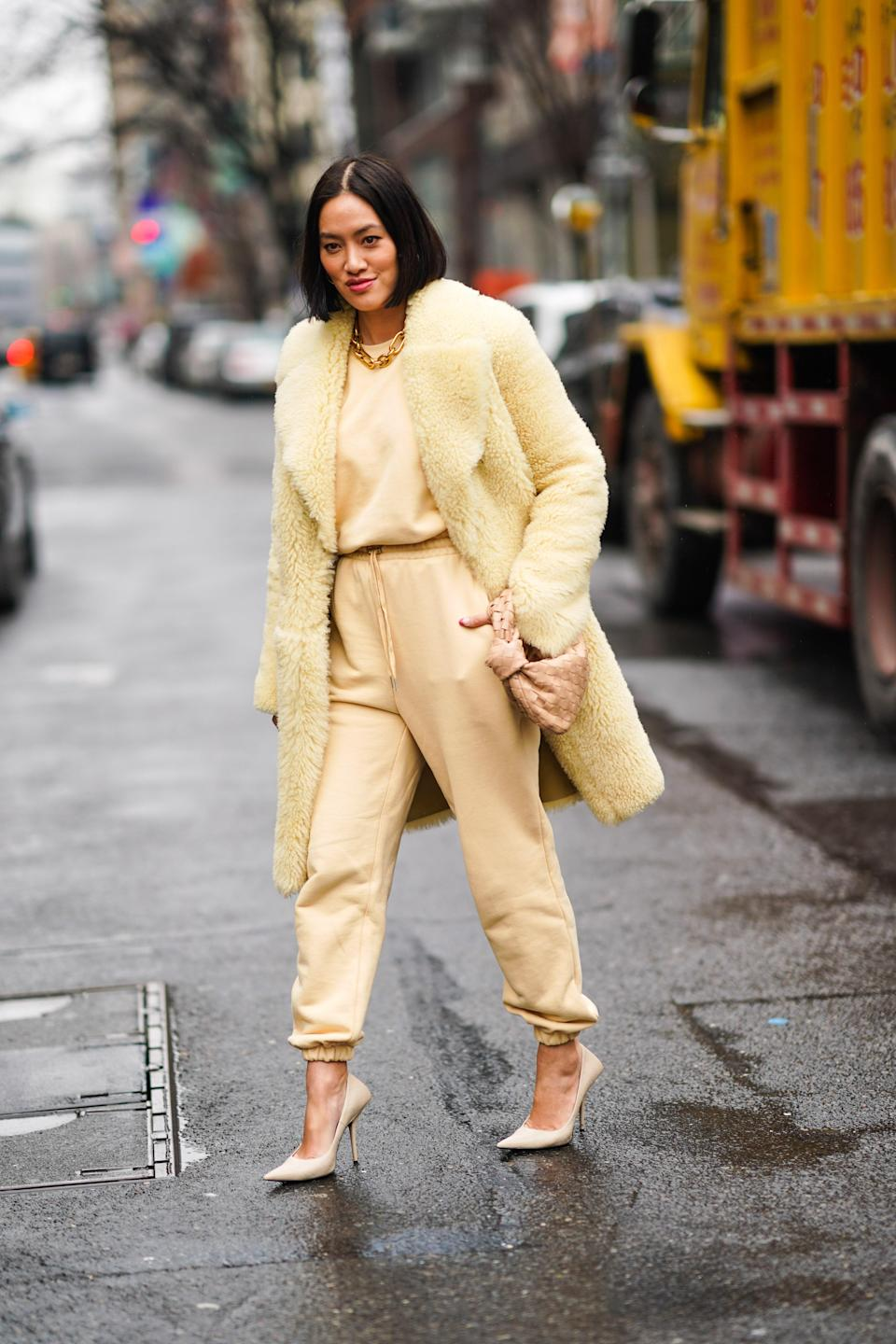 """<a href=""""https://www.glamour.com/gallery/best-sweatpants-for-women?mbid=synd_yahoo_rss"""" rel=""""nofollow noopener"""" target=""""_blank"""" data-ylk=""""slk:Sweatpants"""" class=""""link rapid-noclick-resp"""">Sweatpants</a> proved themselves to be the ultimate wardrobe MVP during quarantine, taking us from couch to grocery store and back again (and again)—but we aren't leaving them at home. Celebrities like <a href=""""https://www.glamour.com/story/katie-holmes-sweatpants-blazer-fall-outfit?mbid=synd_yahoo_rss"""" rel=""""nofollow noopener"""" target=""""_blank"""" data-ylk=""""slk:Katie Holmes"""" class=""""link rapid-noclick-resp"""">Katie Holmes</a> showed us how they can help you turn a <em>lewk</em>, and the pandemic ushered in options beyond standard grey. You can now find plenty of joggers in bold hues, head-turning prints, and <a href=""""https://www.glamour.com/gallery/brown-neutral-trend?mbid=synd_yahoo_rss"""" rel=""""nofollow noopener"""" target=""""_blank"""" data-ylk=""""slk:fresh neutrals"""" class=""""link rapid-noclick-resp"""">fresh neutrals</a>."""