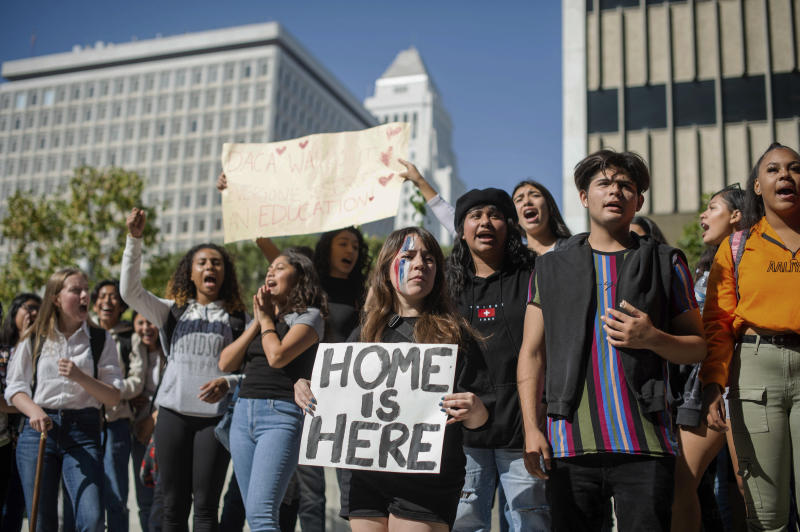 Students walk out of school in Los Angeles to defend the Deferred Action for Childhood Arrivals program, while the U.S. Supreme Court considers the fate of the Obama-era immigration program being challenged by the Trump administration on Tuesday, Nov. 12, 2019. (Sarah Reingewirtz/The Orange County Register/SCNG via AP)