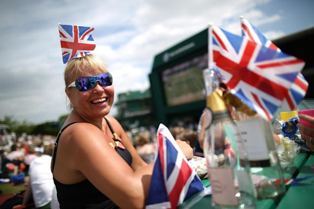LONDON, ENGLAND - JULY 01: A tennis fan wears a Union flag in her hair as she waits for play to start on day seven of the Wimbledon Lawn Tennis Championships at the All England Lawn Tennis and Croquet Club on July 1, 2013 in London, England. (Photo by Peter Macdiarmid/Getty Images)