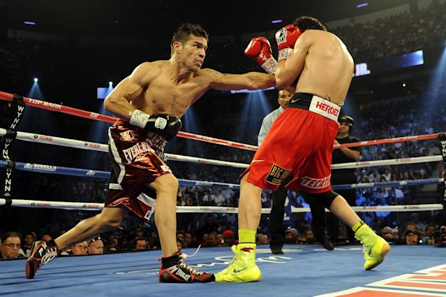 LAS VEGAS, NV - SEPTEMBER 15: Sergio Martinez lands a left punch to the body of Julio Cesar Chavez Jr. in the 12th round of their WBC middleweight title fight at the Thomas & Mack Center on September 15, 2012 in Las Vegas, Nevada. (Photo by Jeff Bottari/Getty Images)