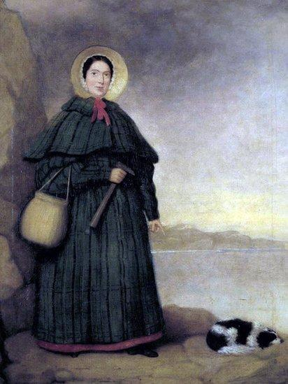 A portrait of Mary Anning donning a cape and bonnet. She's holding a hammer and a basket for her fossils, and her dog Tray is asleep at her feet.