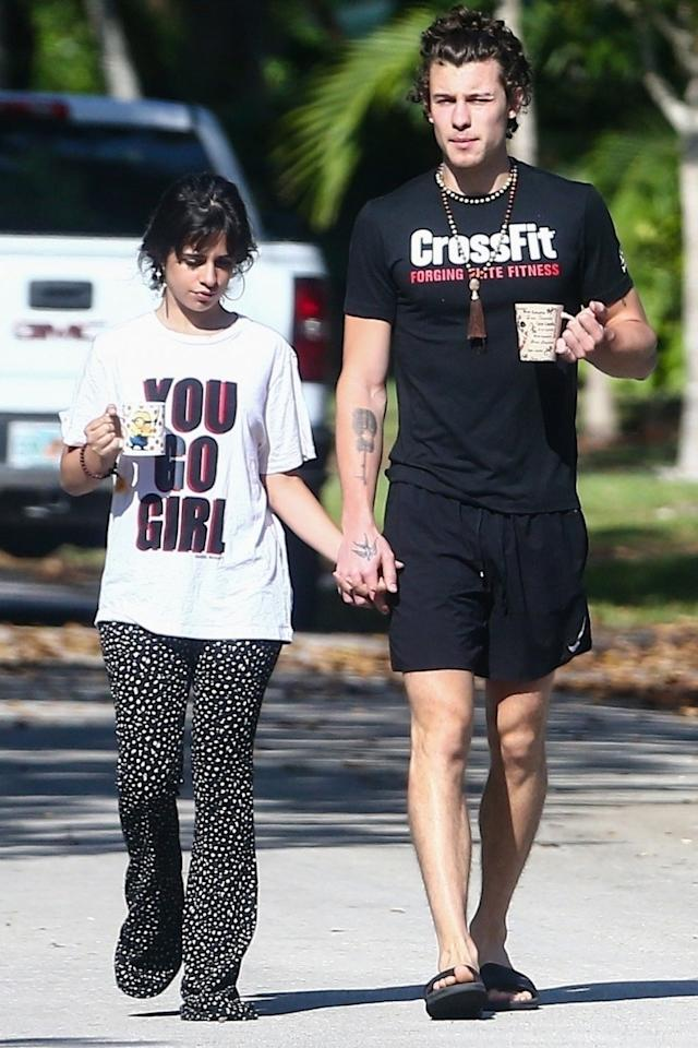 <p>Camila Cabello and Shawn Mendes stay hand-in-hand for their morning walk in Florida on Saturday, complete with cups of coffee.</p>