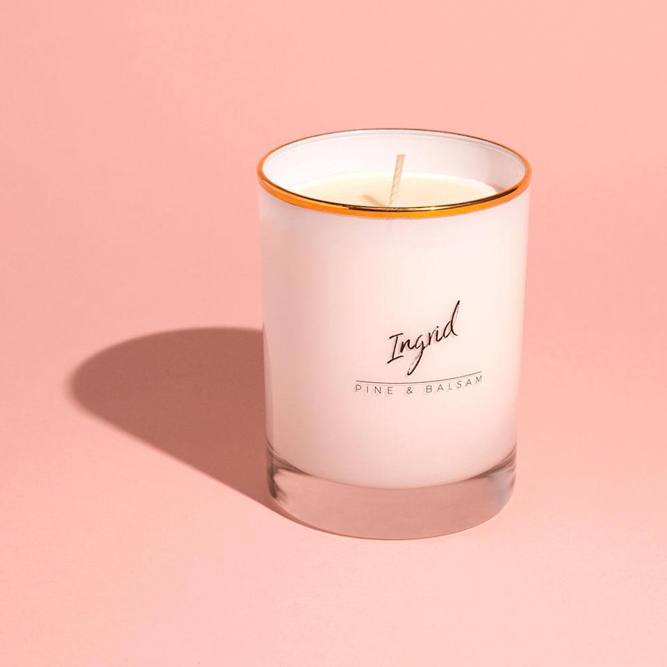 """<p><strong>Bijou Candles</strong></p><p>bijoucandles.com</p><p><strong>$9.00</strong></p><p><a rel=""""nofollow"""" href=""""https://bijoucandles.com/collections/scents/products/ingrid-pine-balsam"""">BUY NOW</a></p><p>Crisp frosted cedarwood and fir needle balsam are made merry and bright with sweet apple, orange bitters, and elderberry. </p>"""