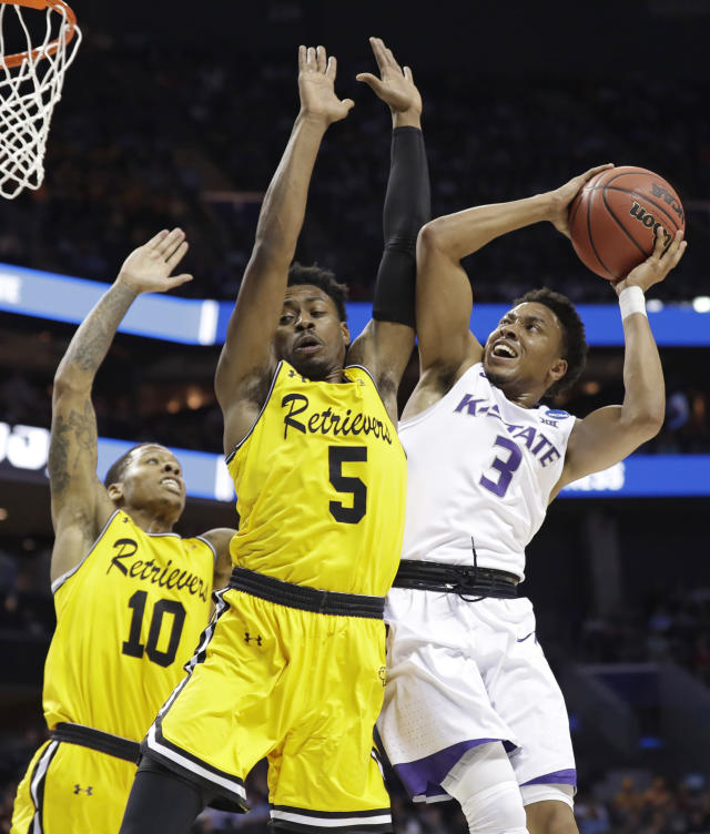 Kansas State's Kamau Stokes (3) drives against UMBC's Jourdan Grant (5) and Jairus Lyles (10) during the first half of a second-round game in the NCAA men's college basketball tournament in Charlotte, N.C., Sunday, March 18, 2018. (AP Photo/Gerry Broome)