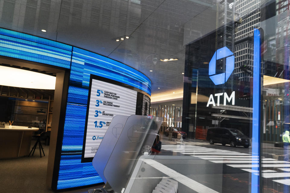 A Chase ATM is open, Wednesday, Jan. 13, 2021 in New York. JPMorgan Chase & Co., the nation's largest bank by assets, said its fourth quarter profits jumped by 42% from a year earlier, as the firm's investment bank division had a stellar quarter and the bank's balance sheet improved despite the pandemic. (AP Photo/Mark Lennihan)