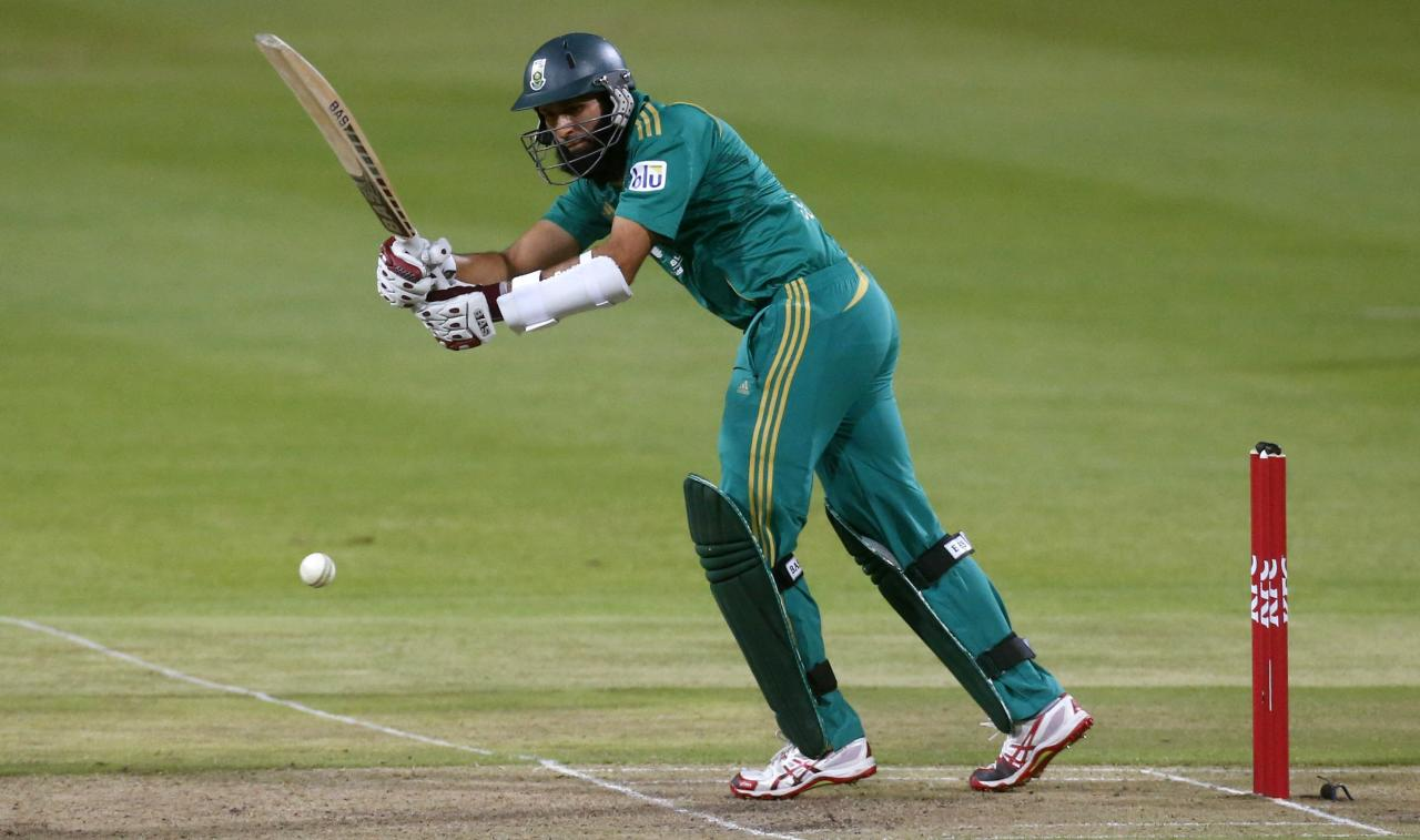 South Africa's Hashim Amla plays a shot during the second Twenty20 cricket match against Pakistan in Cape Town, November 22, 2013. REUTERS/Mike Hutchings (SOUTH AFRICA - Tags: SPORT CRICKET)