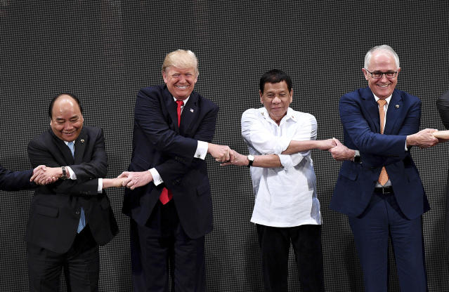 <p>From left, Vietnamese Prime Minister Nguyen Xuan Phuc, U.S. President Donald Trump, Philippine President Rodrigo Duterte, Australian Prime Minister Malcolm Turnbull, link their hands during the opening ceremony of the 31st ASEAN Summit in Cultural Center of the Philippines in Manila, Philippines, Monday, Nov. 13, 2017. (Noel Celis/Pool Photo via AP) </p>