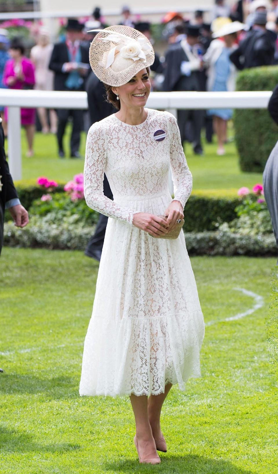 <p>Kate went for a lacy white Dolce & Gabbana dress and an eye-catching Jane Taylor hat in 2016.<br><i>[Photo: PA]</i> </p>