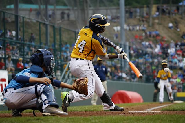 Chicago's Brandon Green drives in the go-ahead run with a fielder's choice in the fifth inning of the United States Championship baseball game against Las Vegas at the Little League World Series, Saturday, Aug. 23, 2014, in South Williamsport, Pa. Chicago won 7-5. At left is Josiah Cromwick. (AP Photo/Matt Slocum)