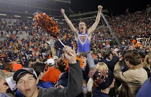 Auburn fans storm the field after the Tigers' 34-28 Iron Bowl win over Alabama. (AP)