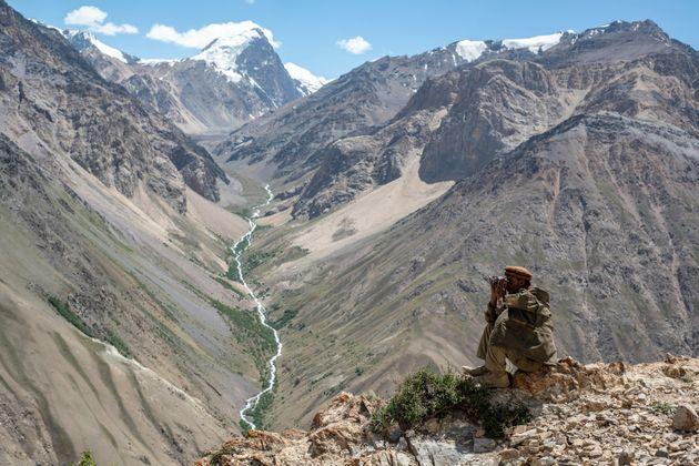 A Wakhi man looks out to the mountains in the Wakhan Corridor of Afghanistan. (Photo by: Tom McShane/Loop Images/Universal Images Group via Getty Images) (Photo: Loop Images via Getty Images)