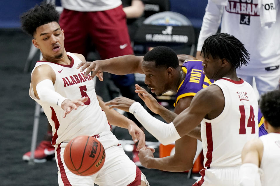 Alabama's Jaden Shackelford (5) battles for the ball with LSU's Aundre Hyatt during the first half of the championship game at the NCAA college basketball Southeastern Conference Tournament Sunday, March 14, 2021, in Nashville, Tenn. (AP Photo/Mark Humphrey)