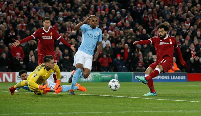 <p>Soccer Football – Champions League Quarter Final First Leg – Liverpool vs Manchester City – Anfield, Liverpool, Britain – April 4, 2018 Liverpool's Mohamed Salah scores their first goal REUTERS/Andrew Yates </p>