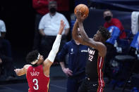 Miami Heat forward Jimmy Butler (22) shoots against New Orleans Pelicans guard Josh Hart (3) during the second half of an NBA basketball game in New Orleans, Thursday, March 4, 2021. (AP Photo/Gerald Herbert)