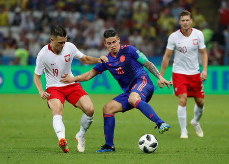 Soccer Football - World Cup - Group H - Poland vs Colombia - Kazan Arena, Kazan, Russia - June 24, 2018 Colombia's James Rodriguez in action with Poland's Piotr Zielinski REUTERS/Toru Hanai
