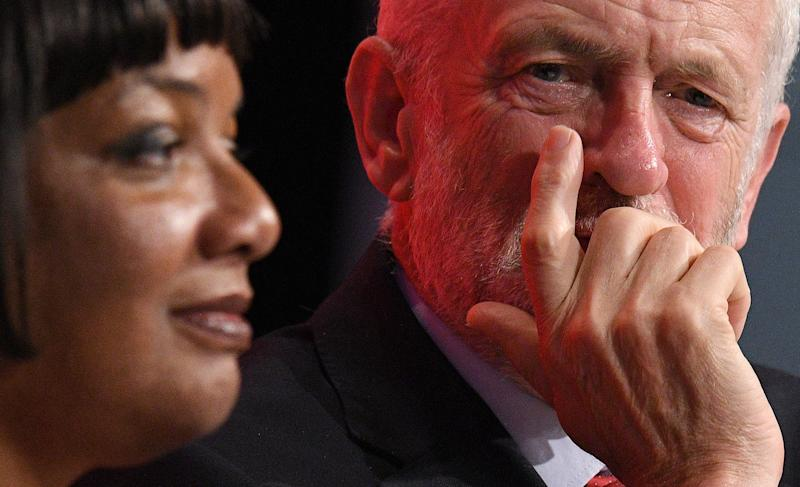 Britain's opposition Labour Party Shadow Home Secretary Diane Abbott (L) and Britain's opposition Labour party leader Jeremy Corbyn listen to a speech on the third day of the Labour party conference in Liverpool, north west England on September 25, 2018. (Photo by Oli SCARFF / AFP) (Photo credit should read OLI SCARFF/AFP/Getty Images)
