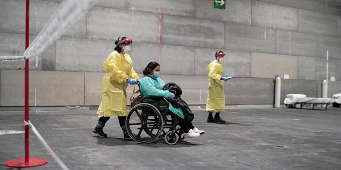 A coronavirus patient arrives at Madrid's IFEMA conference center, which has been turned into a field hospital, on Saturday.