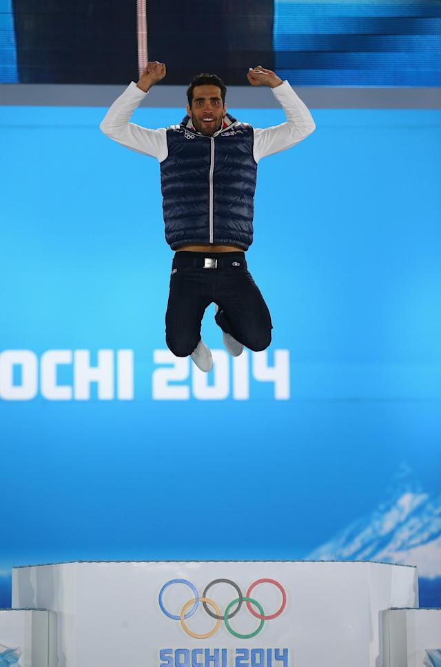 SOCHI, RUSSIA - FEBRUARY 11: Gold medalist Martin Fourcade of France celebrates during the medal ceremony for the Men's 12.5 km Pursuit on day 4 of the Sochi 2014 Winter Olympics at Medals Plaza on February 11, 2014 in Sochi, . (Photo by Streeter Lecka/Getty Images)