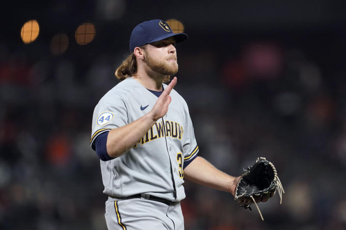 Milwaukee Brewers pitcher Corbin Burnes reacts after striking out San Francisco Giants' Buster Posey to end the sixth inning of a baseball game in San Francisco, Monday, Aug. 30, 2021. (AP Photo/Jeff Chiu)