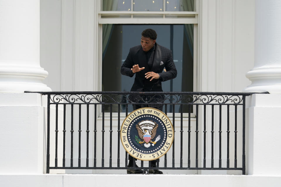 Tampa Bay Buccaneers cornerback Sean Murphy-Bunting reacts after being asked to get down from the balcony at the White House before a ceremony on the South Lawn of the White House, in Washington, Tuesday, July 20, 2021, where President Joe Biden will honor the Super Bowl Champion Tampa Bay Buccaneers for their Super Bowl LV victory. (AP Photo/Andrew Harnik)