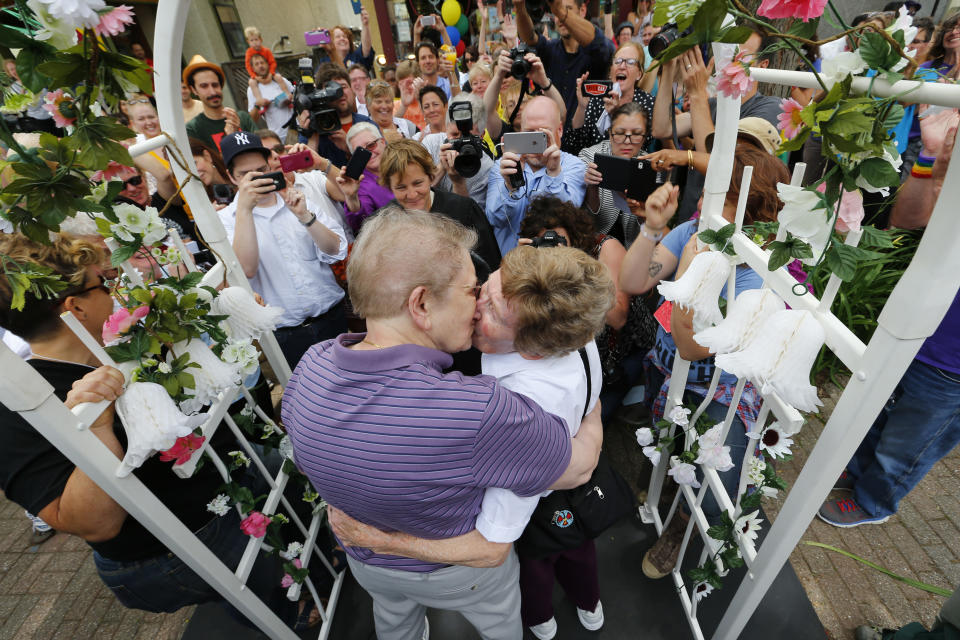Ann Sorrell, 78, left, and Marge Eide, 77, of Ann Arbor, a couple for 43 years, embrace after exchanging vows in Ann Arbor, Mich., following a ruling by the US Supreme Court that struck down bans on same sex marriage nationwide Friday, June 26, 2015. (AP Photo/Paul Sancya)