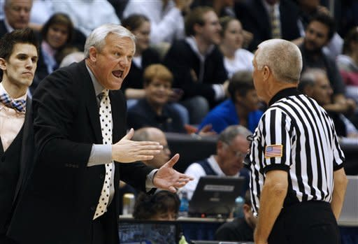 Mercer head coach Bob Hoffman speaks to an official during a second-round game against BYU of the NIT college basketball tournament on Monday, March 25, 2013, in Provo, Utah. (AP Photo/The Deseret News, Tom Smart)