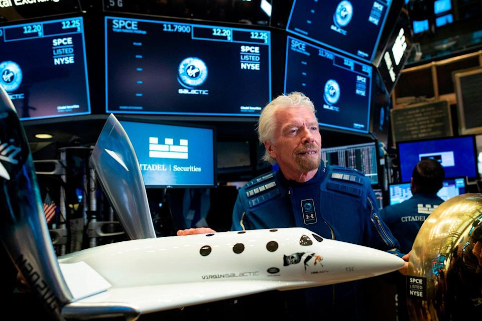 Virgin Galactic poses before ringing the First Trade Bell to commemorate the company's first day of trading on the New York Stock Exchange (NYSE) on October 28, 2019 in New York City.