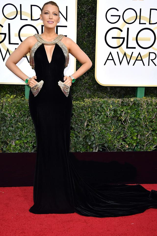 <p>Blake Lively wore a custom black velvet Atelier Versace gown with Swarovski crystal chain-mail details and a sweetheart cutout. And how can we ignore those stunning Lorraine Schwartz emerald-and-diamond cuffs?! (Photo: Getty Images) </p>