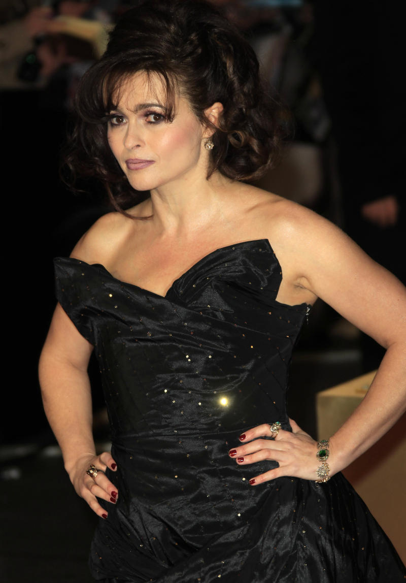 "FILE - In this Wednesday, Dec. 5, 2012 file photo, Helena Bonham Carter arrives on the red carpet for the World Premiere of ""Les Miserables"" at a central London cinema in Leicester Square.  A report from Ancestry.com says Victor Hugo was a political colleague of a cousin of the 46-year-old actress. Carter stars as Madame Thenardier in the upcoming musical ""Les Miserables."" (Photo by Joel Ryan/Invision/AP, File)"
