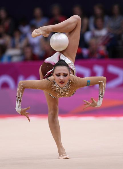 LONDON, ENGLAND - AUGUST 09: Anna Alyabyeva of Kazakhstan performs with the ball during the Rhythmic Gymnastics qualification on Day 13 of the London 2012 Olympics Games at Wembley Arena on August 9, 2012 in London, England. (Photo by Julian Finney/Getty Images)