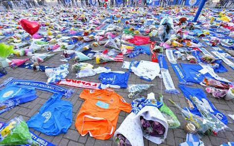 <span>Fans and mourners pay their respects at Leicester City's King Power Stadium</span> <span>Credit: Getty Images </span>