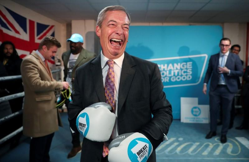 Brexit Party leader Nigel Farage wears boxing gloves during a visit at a boxing gym in Ilford
