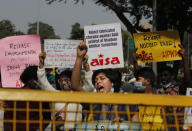 Indian students shout slogans demanding the release of Dalit labor rights activists Nodeep Kaur and Shiv Kumar and climate activist Disha Ravi during a protest in New Delhi, India, Monday, Feb.15 2021. Kaur and Kumar were arrested by police in January on a series of charges while Ravi was arrested Saturday for circulating a document on social media that allegedly incited protesting farmers to turn violent last month. (AP Photo/Manish Swarup)
