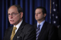 FILE - Securities Investor Protection Act Trustee Irving Picard, left, is joined by U.S. Attorney for the Southern District of New York Preet Bharara during a news conference, in New York, on Dec. 17, 2010. More than 12 years after Bernard Madoff confessed to running the biggest financial fraud in Wall Street history, a team of lawyers is still at work on a sprawling effort to recover money for the thousands of victims of his scam. Ongoing litigation by Picard and his chief counsel could potentially pull in billions of dollars more than already secured. (AP Photo/Mary Altaffer, File)