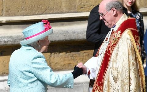 The Queen is welcomed to church by The Dean of Windsor, David Conner - Credit: Rex